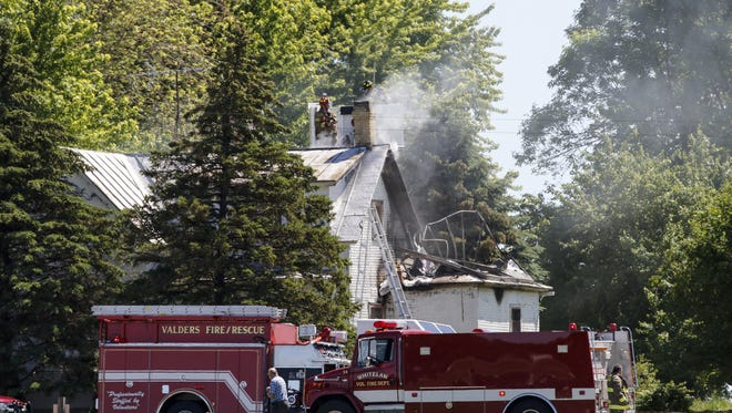 Fire departments work to put out a fire at 4107 Marken Road Wednesday, Jun. 7, 2017, in Valders, Wis. Officials say the residence was unoccupied. Josh Clark/USA TODAY NETWORK-Wisconsin