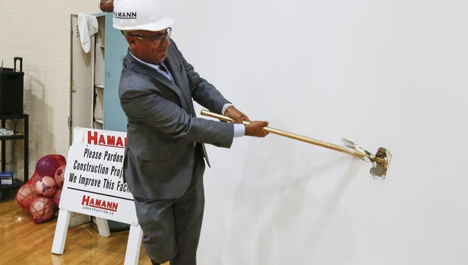 """Dr. Ashok Rai, president and CEO of Prevea Health, does the honor of taking the first swing during the Manitowoc-Two Rivers YMCA """"Building what Matters"""" groundbreaking in July."""