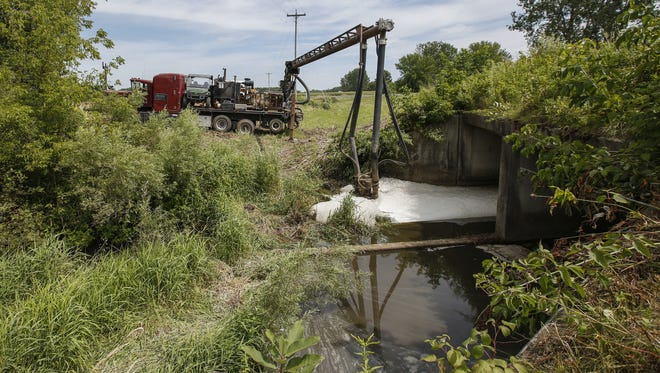 A truck pumps manure out of Pine Creek after runoff from a nearby dairy farm reached the Manitowoc County tributary Wednesday, Aug. 9, 2017, in Newton, Wis. Josh Clark/USA TODAY NETWORK-Wisconsin