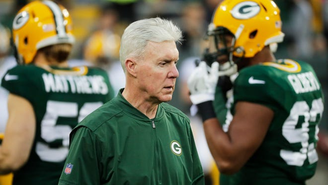 Green Bay Packers general manager Ted Thompson walks onto the field at the Packers' night practice Saturday, Aug. 5 at Lambeau Field.