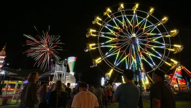 Fireworks close the opening day at the Manitowoc County Fair Tuesday in Manitowoc.