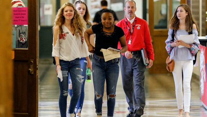 File - Manitowoc Lincoln High School students make their way to class on the first day of school on Sept. 5, 2017, in Manitowoc.