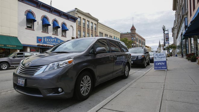 A car is parked in a space on Eighth Street in Manitowoc that may be used for a parklet in the future.
