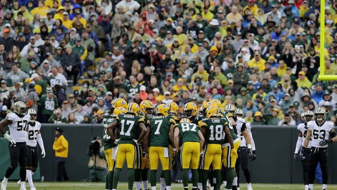 Green Bay Packers quarterback Brett Hundley (7) huddles with the offense during the second quarter against the New Orleans Saints at Lambeau Field on Sunday, October 22, 2017 in Green Bay, Wis.  Adam Wesley/USA TODAY NETWORK-Wisconsin