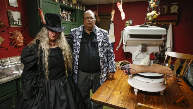 "Dawn and Jim Dabeck pose in costume in their Jeffrey Dahmer-themed kitchen at the Dead by Dawn ""Dead and Breakfast"" Oct. 20 in Manitowoc."