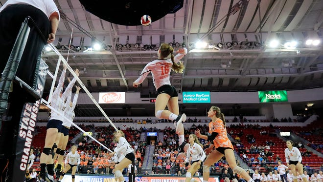 Burlington's Abby Koenen rises for a kill attempt during a state tournament game at the Resch Center, which will host the  boys and girls  tournaments beginning in 2019.