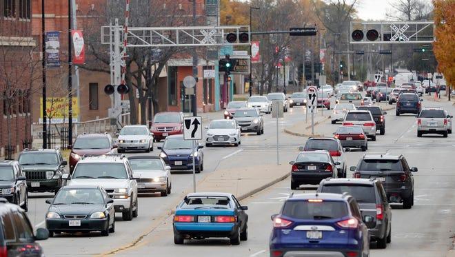 Morning traffic moves along Walnut St. on Thursday, November 9, 2017 in Green Bay, Wis.