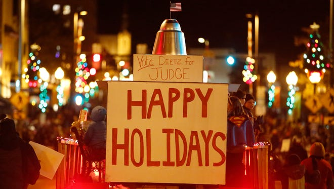 A float wishes everyone happy holidays in the Lakeshore Holiday Parade Wednesday, Nov. 22, 2017, in Manitowoc, Wis. Josh Clark/USA TODAY NETWORK-Wisconsin