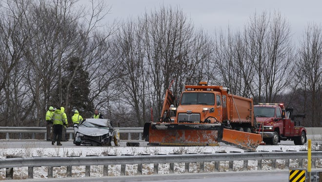 Crews work to clean up a car accident on Interstate 43 Tuesday in Manitowoc County.