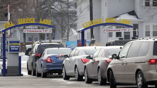Vehicles line up for washes at a PDQ Car Wash on Main  Street in Green Bay.