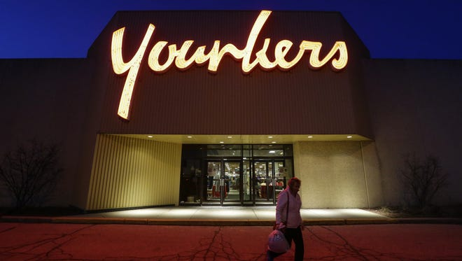 File - A woman leaves the Manitowoc Younkers at 700 E. Magnolia Ave. in January 2018.
