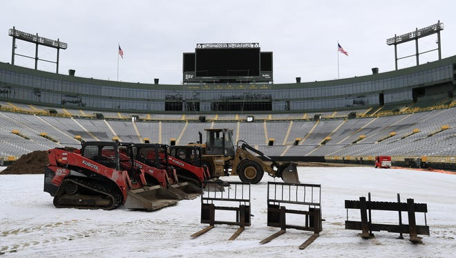 Digging equipment was parked on the field at Lambeau Field as work got underway on replacing the stadium's turf earlier this month. Adam Wesley/USA TODAY NETWORK-Wisconsin