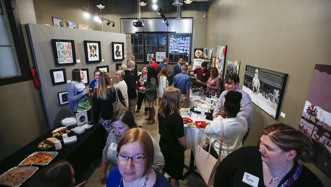 A full house at the Vagabond gallery in the Artist Lofts during the Young Professionals of Manitowoc County Sip, Sample and Socialize event Wednesday, Apr. 26, 2017, in Manitowoc, Wis.
