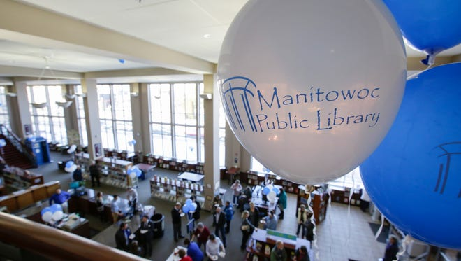 Balloon decorate the balcony of the Manitowoc Public Library during the grand re-opening of Thursdays ribbon cutting Thursday, Feb. 15, 2018, in Manitowoc, Wis. Josh Clark/USA TODAY NETWORK-Wisconsin