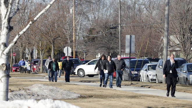 Cars line the street as community members arrive at Kewaunee High School Friday afternoon for the visitation for John Pagel and Steve Witcpalek. Pagel and Witcpalek, his son-in-law, died when the Cessna aircraft they were flying in crashed on Feb. 22 in an Indiana farm field.