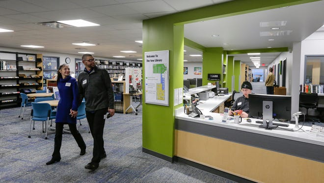 People tour the newly renovated University of Wisconsin-Manitowoc library after the ribbon cutting ceremony Wednesday, Mar. 7, 2018, in Manitowoc, Wis. Josh Clark/USA TODAY NETWORK-Wisconsin