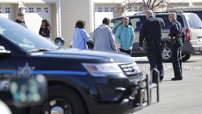 Police talk to neighbors March 15 after shots were fired at Craftsman Village, located at 410 Schindler Place, Appleton.