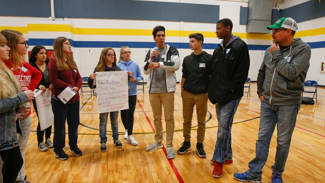 Appleton West High School junior Fernando Martinez-Reding, center, shares with his group during a Sources of Strength training session at the Boys and Girls Club of the Fox Valley Thursday, Nov. 9, 2017, in Appleton, Wis.