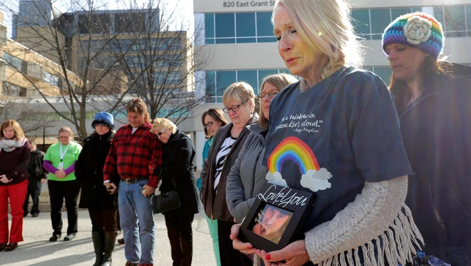 Rhonda Rozelle of Appleton holds a photograph of her son Zach in a moment of silence during a flag-raising ceremony as part of the inaugural Donate Life Wisconsin Pause to Give Life event to bring awareness to the importance of organ, tissue and eye donation Monday, April 2, 2018, at ThedaCare Regional Medical Center-Appleton in Appleton, Wis. Zach Rozelle's organ's were donated in October 2016 following his brain death from a drug overdose.Dan Powers/USA TODAY NETWORK-Wisconsin