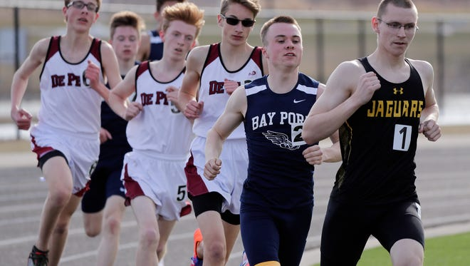 Ashwaubenon's Randy Johnson leads the boys 1600m race at the Red Raider Invitational track meet at Pulaski high school on Thursday, April 26, 2018 in Pulaski, Wis.