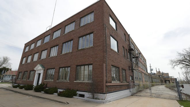 The former Banta Corp. printing plant in Menasha could be redeveloped as a mix of apartments, offices and restaurants.