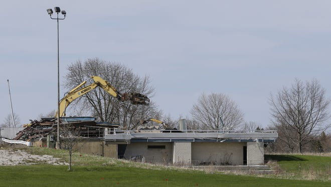 Demolition begins on the former Elks Club golf course May 10 in Manitowoc.