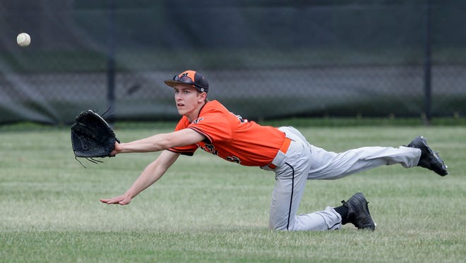 Mishicot's Zachary Skubal (35) dives trying to make a catch against Gibraltar/Washington Island during a WIAA division 3 regional championship game Wednesday, May 30, 2018, in Mishicot, Wis.