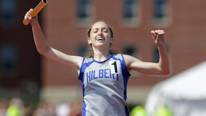 Hilbert/Stockbridge's Makaylee Kuhn celebrates after crossing the finish line in the Division 3 3,200-meter relay Friday at the WIAA state track and field meet at Veterans Memorial Stadium in La Crosse.