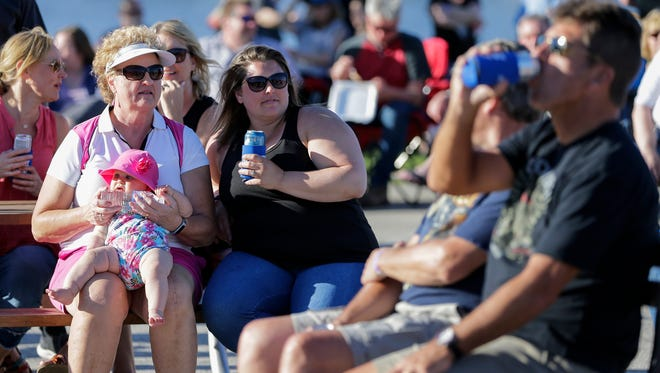Dolores Yanda, left and holding 8-month old Ava Casper, enjoys the music with her goddaughter Trisha Casper during the first Night Market 920 event downtown Wednesday, Jun 13, 2018, in Manitowoc, Wis. Josh Clark/USA TODAY NETWORK-Wisconsin