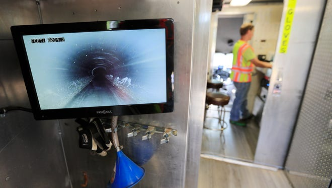 A display shows the view from a remote controlled camera used to inspect sewers by the City of Green Bay on Friday, June 8, 2018 in Green Bay, Wis.
