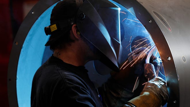 A welder works at American-3 Fab on Friday, June 15, 2018 in De Pere, Wis.