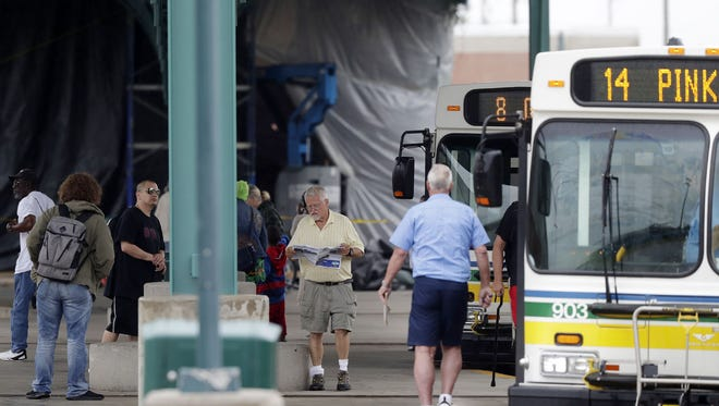 Passengers wait for buses at the Green Bay Metro transportation center  on Monday, June 18, 2018 in Green Bay, Wis.