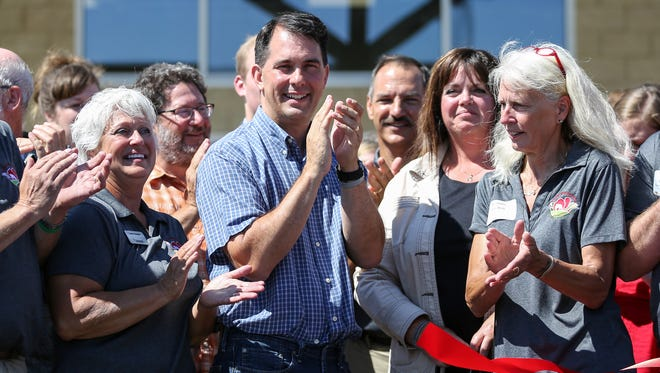 Governor Scott Walker reacts after ribbon cutting in front of the main entrance during a preview event Monday, July 16, 2018, in Manitowoc, Wis. Josh Clark/USA TODAY NETWORK-Wisconsin