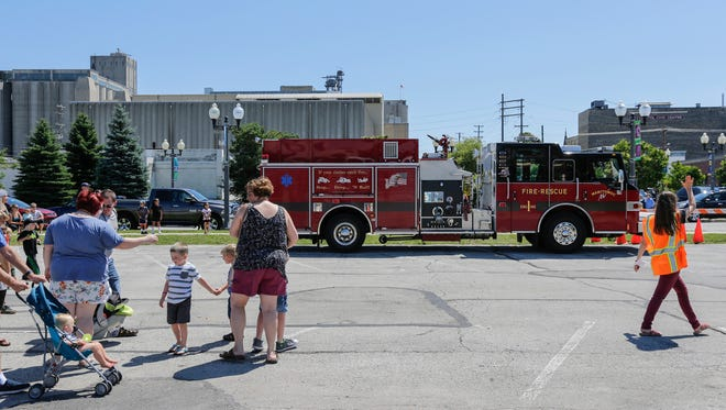 People watch a Manitowoc fire truck park during the Touch the Trucks event put on by the library's children's service department Wednesday, July 18, 2018, in Manitowoc, Wis. Josh Clark/USA TODAY NETWORK-Wisconsin