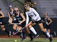 Jessica Dembrowski, of Palmyra,right, brings the ball up the field during Palmyra's 2-0 win over Council Rock South in the first round of the PIAA Class 3A Field Hockey Championship at Milton Hershey on Tuesday night.