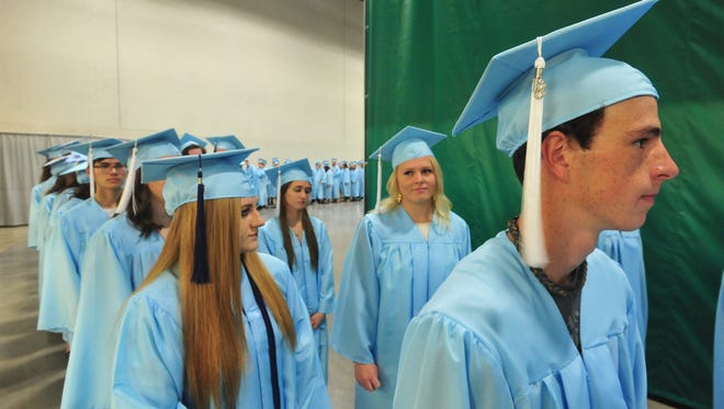 The graduate processional begins the Great Falls High School Class of 2018 commencement ceremony on Sunday, May 27, 2018, in the Four Seasons Arena. Great Falls High graduated 224 seniors, Sunday.