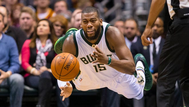 Milwaukee Bucks center Greg Monroe saves the ball from going out of bounds against the Cleveland Cavaliers.