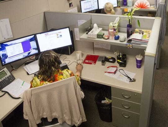Call center employees at the Alzheimer's Association field calls from people looking for information about the disease.