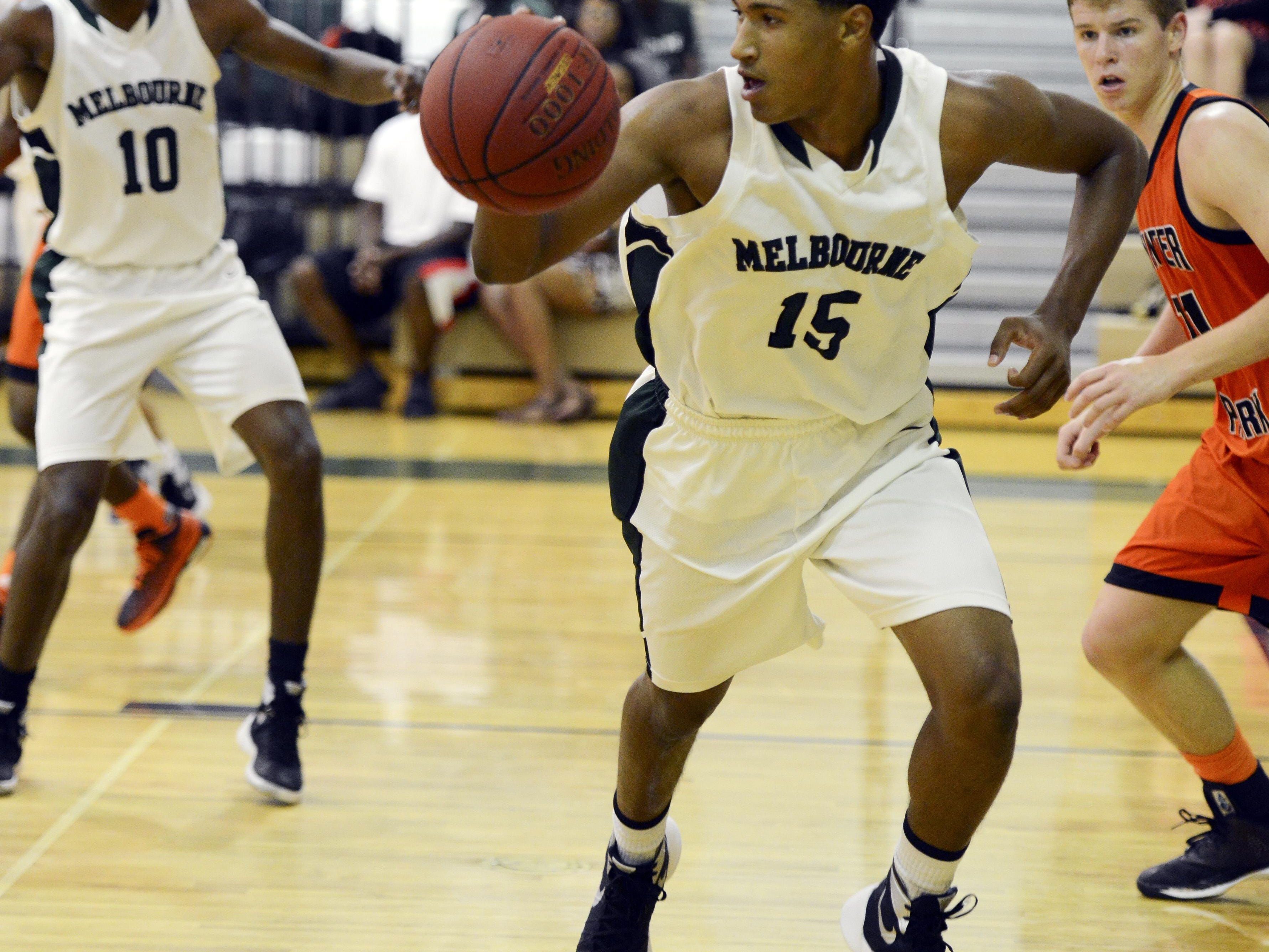 Melbourne's Dezmond Morgan (15) heads downcourt on a fast break during Tuesday's game against Winter Park.
