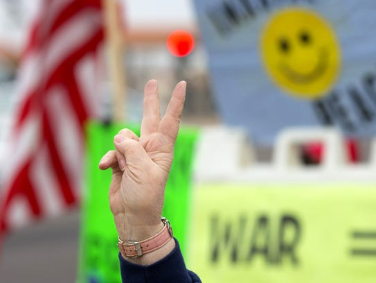 Joan Kroll, 76, of Sun City West, gathers with a group