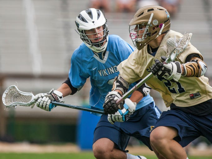 Sallies' Andrew Witherell, right, runs up the field as Cape's Todd Keen, left, defends, in the first quarter of Salesianum's 14-7 win over Cape Henlopen at Baynard Stadium in Wilmington on Monday evening, May 12, 2014.