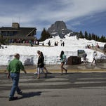 Visitor's to Glacier National Park visit Logan Pass at the top of Going-to-the-Sun Road Thursday, the first day the visitors center and the road were open to the public for the season.