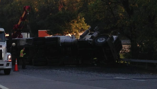 A tractor-trailer lies on its side after overturning during a two-truck collision on the eastbound Interstate 287 ramp to Interstate 684, Oct. 17, 2014.