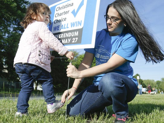 Christy Mannering gets help from one of her children,