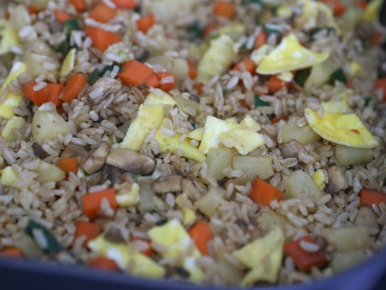 A healthy dish of pineapple fried rice.