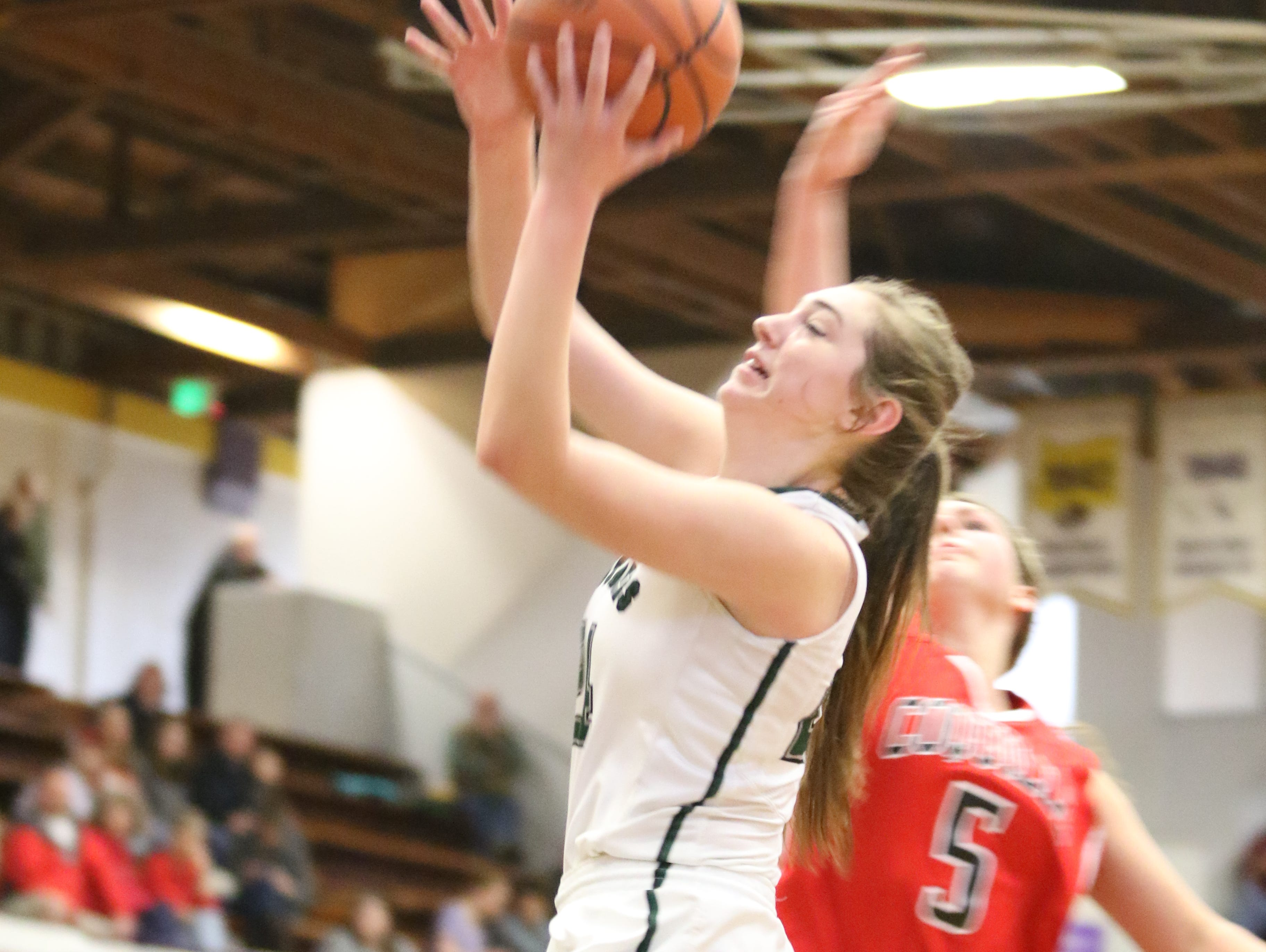 Salem Academy's Sydney Brown goes up for a shot against Coquille at the 3A state tournament on Saturday, March 4, 2017.