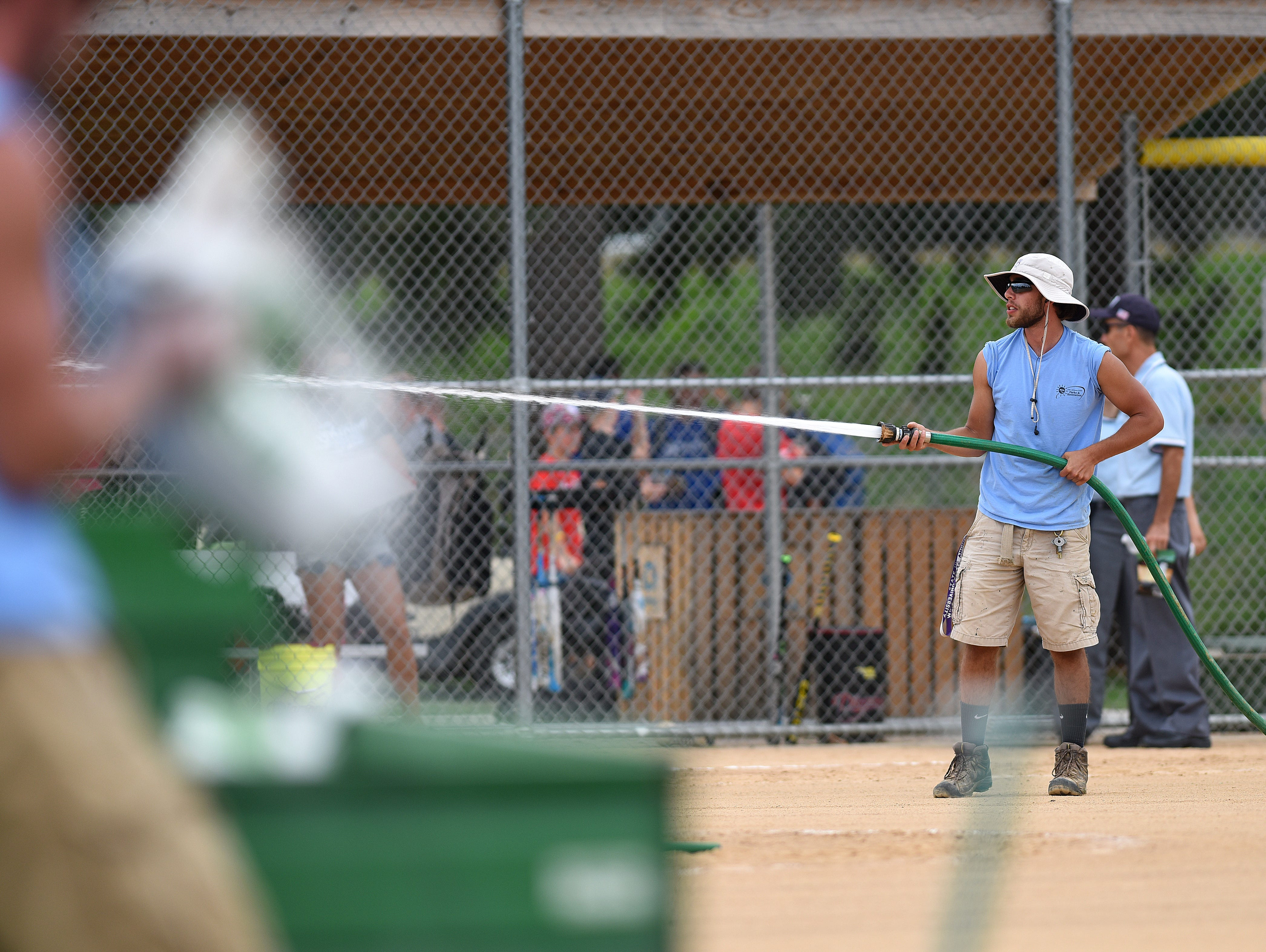 Sioux Falls Park and Rec, Adam Brandner, prepares the softball field before the ASA 14U national softball tournament at Sherman Park in Sioux Falls, S.D., Monday, Aug. 1, 2016.