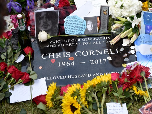 A plaque marking Chris Cornell's gravesite appears,
