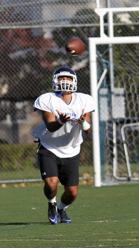Dobbs Ferry's Jibril Kapadia catches a punt during practice at Dobbs Ferry High School on Tuesday, Oct. 20, 2015.