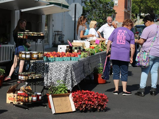 Locals browse selections at one of the Downtown Fremont Farmers Markets.